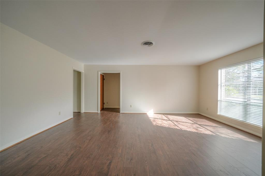 Upon entering the home, you can see the formal living room has lots of natural light.