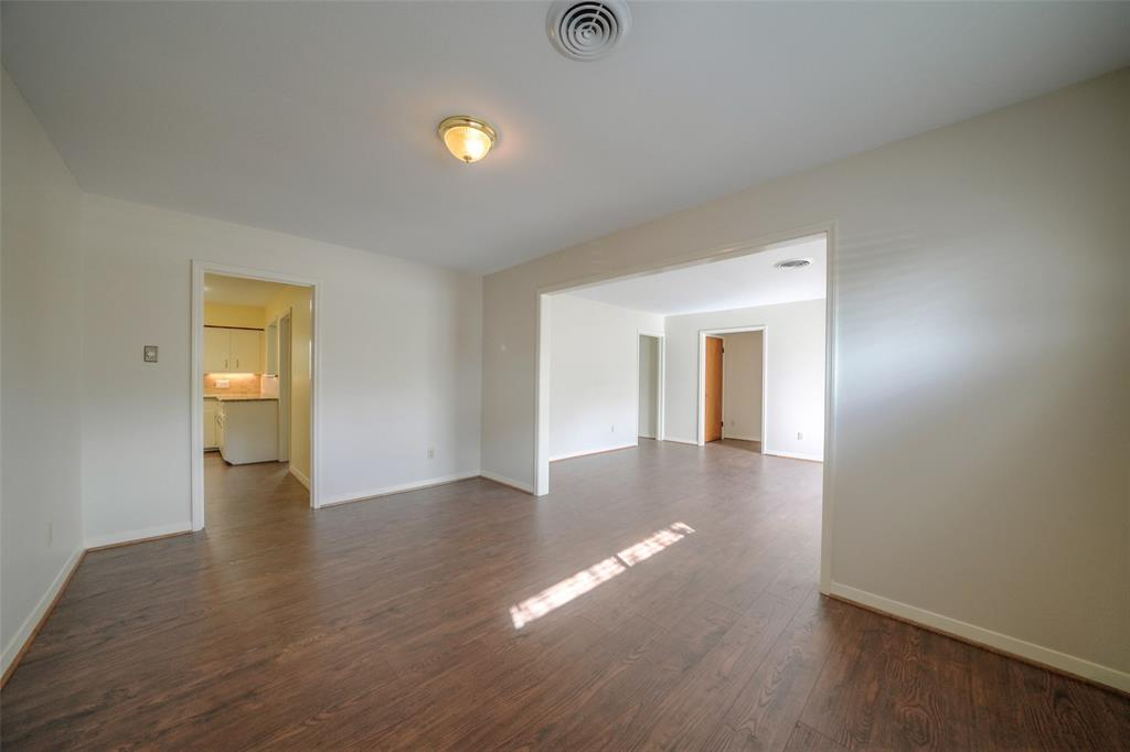 The dining room is spacious with natural light.