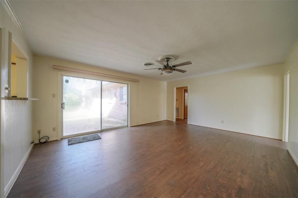 The family room has natural light and doors that lead to the spacious backyard.