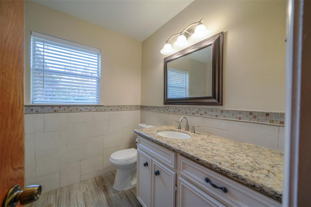 The master bathroom has granite tops and updated fixtures.