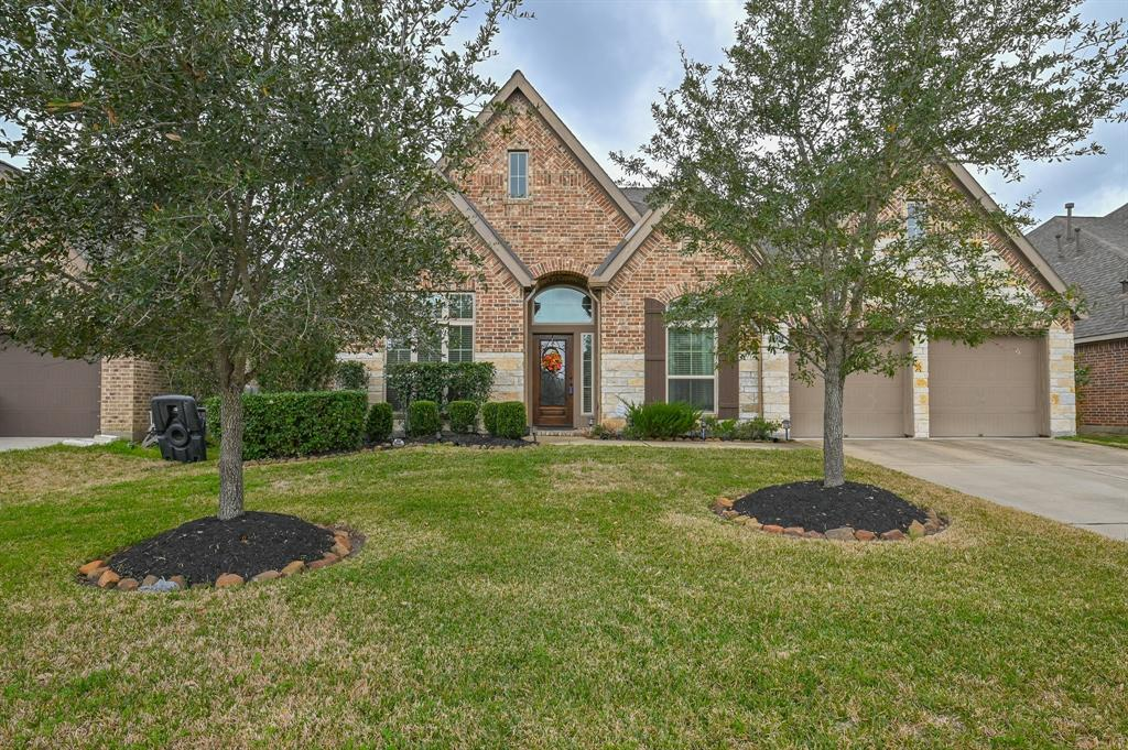 PERFECTLY APPOINTED PERRY, 4/3 home in at Brazos Town Center! This home is a MUST SEE! Library/study and formal dining greet you at the front of the home. This home features a beautiful rotunda in the entry. An open concept living, kitchen & dining room are illuminated by large windows & doors that lead you to your backyard oasis. Soaring ceilings grace the living room. Kitchen features island, breakfast bar, walk-in pantry, butler's pantry & ample cabinet space. Spacious master suite & stunning master bathroom with double sinks & built in vanity area. A large family/game room.The fenced backyard offers a relaxing atmosphere and the clubhouse offers a beautiful pool and spa for relaxation. Local shopping and entertainment that include, Smart Financial Centre, Cinemark Theater, Grocery, Target and other shopping at Brazos Town Center. DID NOT FLOOD