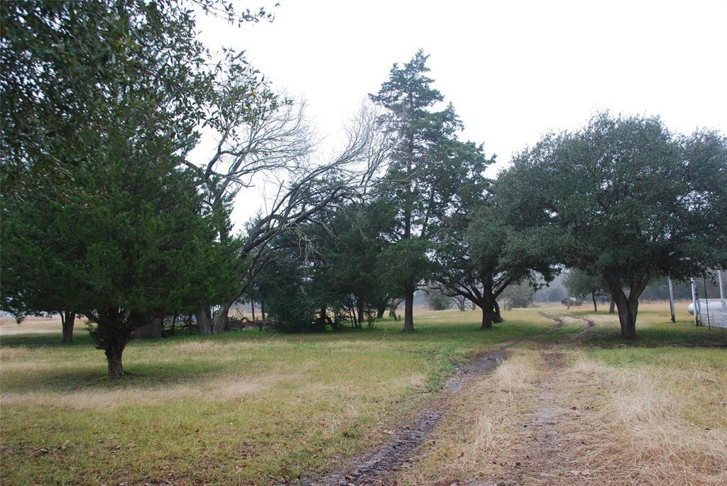 Beautiful, Unrestricted 53+ Acres off paved FM 1372 in North Zulch, Texas.  3/2 Manufactured Home is set up with Utilities and Situated in a Park Like Setting Surrounded by Oaks and Cedars.  This Fenced Property Offers a Wide Variety of Uses with it's two Large Stocked Ponds, Barns and Open Pastures.  This Beautiful Property Offers a Great Opportunity for your Dream Home, Livestock, Hunting and Fishing!  Just a Short Drive to Bryan/College Station.  Bring the Family and Let the Memories Begin!