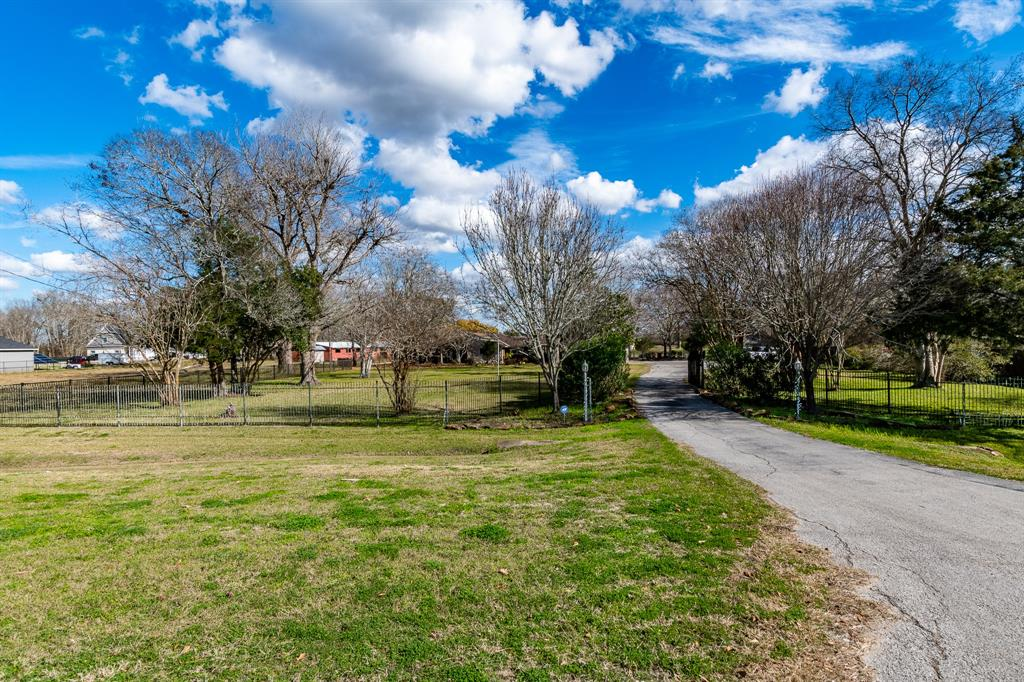 34 Acres of unrestricted land in Huffman. Beautiful updated home with an open floor plan. Sun room faces back of the property. Nice pool and covered patio. Covered area for RVs. Listed as 3 bedrooms but the office can be the 4th bedroom. Two entrances to the property, main entrance off FM 2100, back entrance off Yoakam and 3rd street.  10 stall barn, separate workshop and pond on the property. Mobile home (about 700 sq.ft) at back of property. Could be used as a guest house or rental. Front of property can be zoned as commercial. Upon request furniture in the home can stay. Appliances will stay with the home.