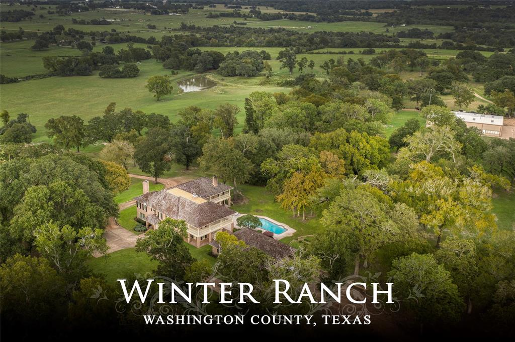 First time offering in 35+ years! Approx. 193+ acres featuring high rolling hills with countryside views and groves of giant Live Oak trees located near historic Independence. A winding drive leads up to the custom built home sitting on a high rolling ridge away from the road and perfectly placed in the middle of the property. The house offers a stately ±6126 SF, four bedrooms, four full and one half baths, downstairs master bedroom, office, two living areas, large dining room, kitchen with keeping-breakfast room and fireplace and great views from the porches. Other improvements include a Swimming Pool; Shop Building with area for equipment storage and workshop/office; Roping/Riding Arena; Cross-Fencing; and 3 ponds with the potential for a large lake site. The property is the perfect mix of meadows with mature trees, wooded areas for wildlife habitat and a fork of Jackson Creek traverses through the front portion of the property.