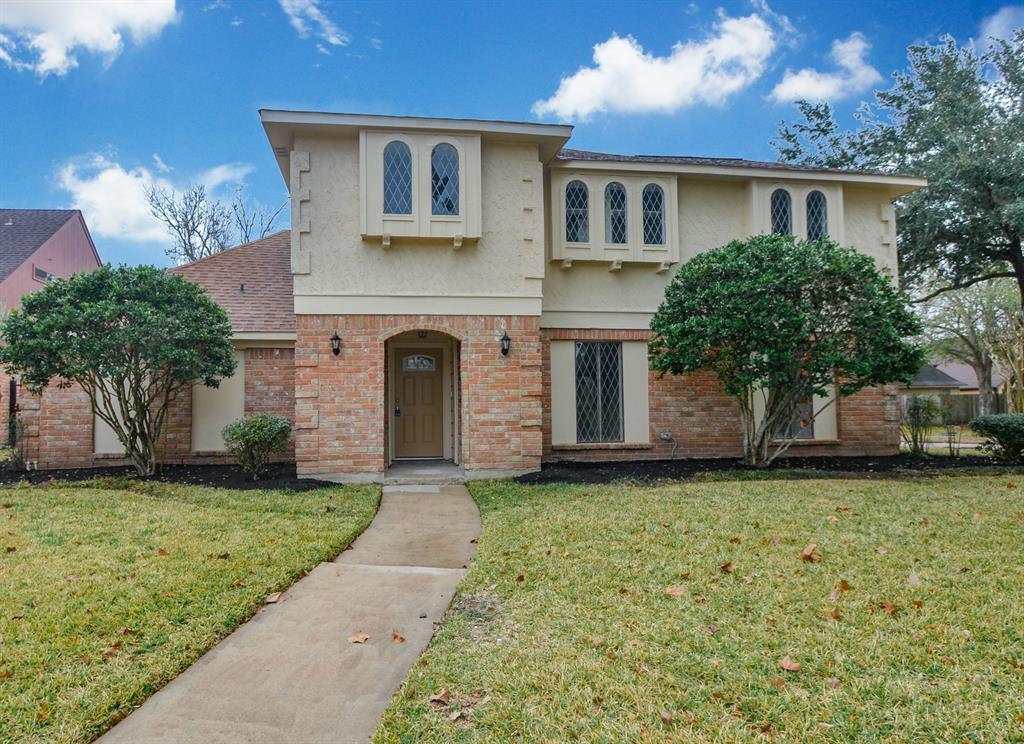 NEVER FLOODED AS PER SELLER. Corner lot zoned to great schools. COMPLETE REMODEL with NEW: AIR CONDITIONING SYS, Hot water heater, foundation repair with warranty, interior and exterior paint (walls, ceilings, doors, trim), all flooring - tile and carpet, tiled fireplace, kitchen cabinets, master bathroom vanity, cabinet knobs, all granite countertops, tile backsplash, stainless steel appliances, front door, back door, side garage door, laundry room door, recessed lighting in family room, kitchen, dining room, master bath and guest bath, 6 sinks, 6 faucets, 2 elongated toilets, 7 designer bathroom mirrors, towel hardware, 2 tiled tub surround showers, 5 ceiling fans, all interior and exterior light fixtures, all door knobs & locks, all electrical switches and outlets, with 5 large walk-in closets and 4 large bedrooms. Recently replaced driveway and hardie board siding on house.