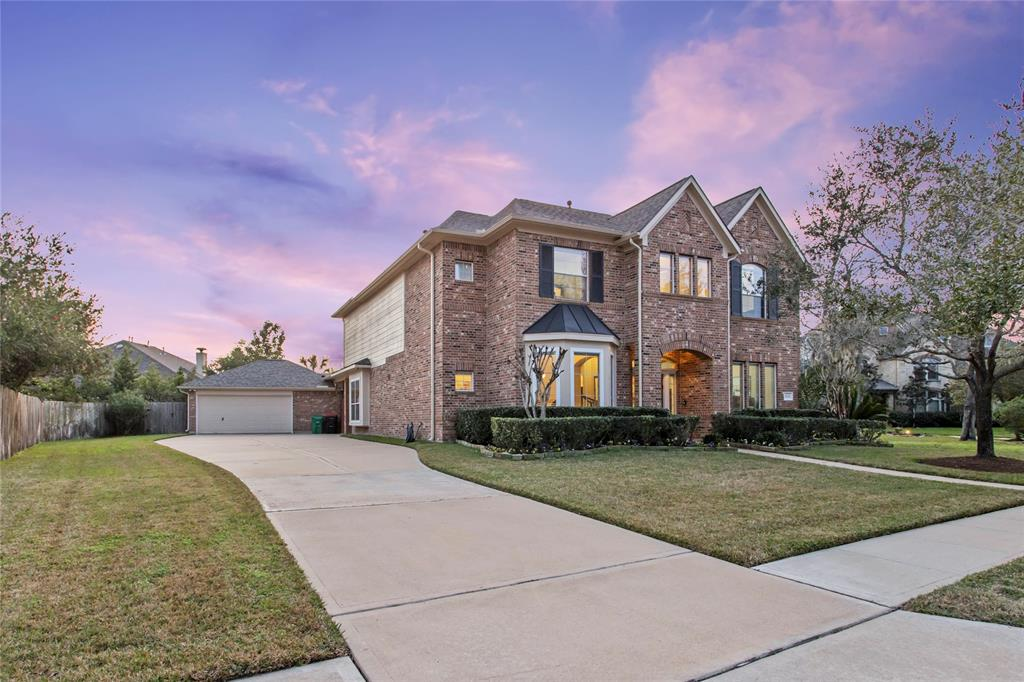 Welcome to 8734 Stowe Creek Ln in the Master Planned Community of Sienna Plantation. This home offers 4 lg bedrooms, 3.5 Bathrms, Grand Entry with curved staircase, Formal Dining with Wood Flooring, Formal Living (used as Study) with Wood Flooring, Family Room with custom built-ins on each side of the Stone Fireplace & Opened to Gourmet Kitchen (recent Stainless Steel Appliances 2019) HUGE Master Bedroom with Sitting Area and Spa Like Master Bath offering 3 Dressing areas, Spa tub and 2 Master Closets! The 2nd Floor has 3 Lg Bedrooms and 2 Bathrooms, a built-in work station with 2 desks, GAME ROOM with French doors Leading to Balcony and a 2 Level Media Room! Bring the FUN outdoors, Covered Patio, Outdoor kitchen w/ Grill, Frig & sink, 40k Gallon Resort style pool & Spa, Mosquito systm, Rock waterfall, Swim under Grotto, Fire pit and so much more! See Highlights in Attachments. Walking distance to Baseball, soccer, softball fields, Horse Stables and Schools! 2019 ROOF!  Call us TODAY !