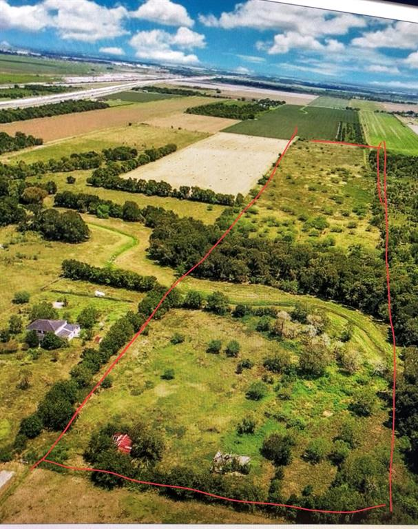 38.182 acres of Beautiful Wooded land with the San Bernard canal running through the front portion. 