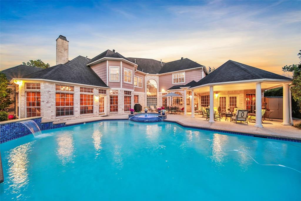 This luxurious home sits on the corner of a quiet cul-de-sac street & backs to the lake. Filled w/elegant touches throughout including a grand sweeping staircase, huge windows w/plantation shutters, gorgeous wood floors, & generous room sizes. This home is meant to entertain w/a backyard oasis including a heated pool & in-ground spa surrounded by extended decking & lush landscaping. Living room w/a gas-log fireplace & sunken wet-bar. Formal dining w/elegant details. The 1st floor master suite is stunning w/rich wood work, French doors leading to the pool area, & a luxurious spa-like bath w/2huge walk-in closets. Incredible views of the pool can be seen from the gourmet kitchen, breakfast area, & den with rich wood paneling, stacked windows, & a gas-log fireplace. Spacious 2nd floor guest bedrooms & full baths. The 4 car garage + circular drive means ample parking. KISD schools. Great location near shopping & dining. Too many details to mention here, call today for your private showing.