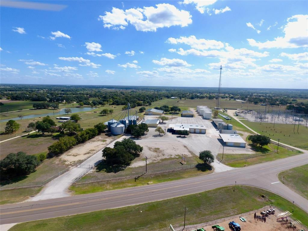 Feed, & Seed Facility, Warehouse Storage, Office Space, and Commercial Development opportunity all along US Hwy 90 frontage in Hallettsville, Tx! 25.75 acres for additional use with a pond. 60,000 SF asphalt parking area with a 1,200 SF fueling area. Just minutes from US Hwy 77 intersection and US Hwy 77A, provides easy access for customers and multiple roadways from trucking and hauling. Truly a rare opportunity to purchase a unique facility for your Ag Supply business!