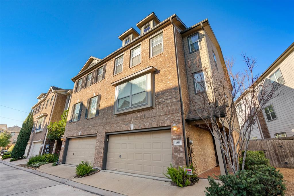 Beautifully maintained and updated, end-unit townhome with a large yard and additional parking.  This home is located in a gated community that is high and dry with no flooding.