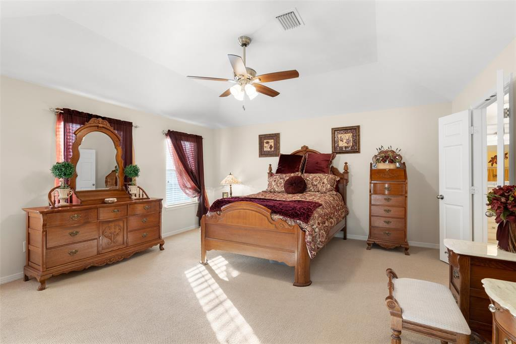 The over-sized master suite with large walk-in closet features new interior paint and new ceiling fan.