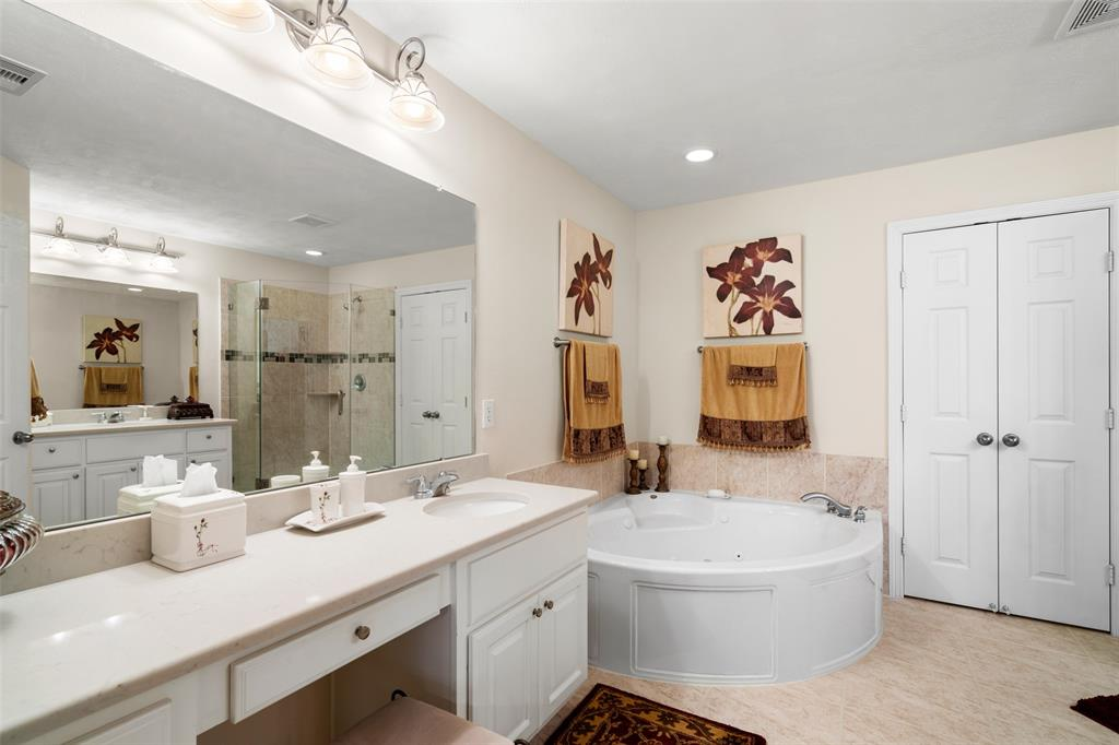The luxurious master bath features dual vanities with updated quartz counter tops and under-mount sinks.  You will love the large jetted tub.