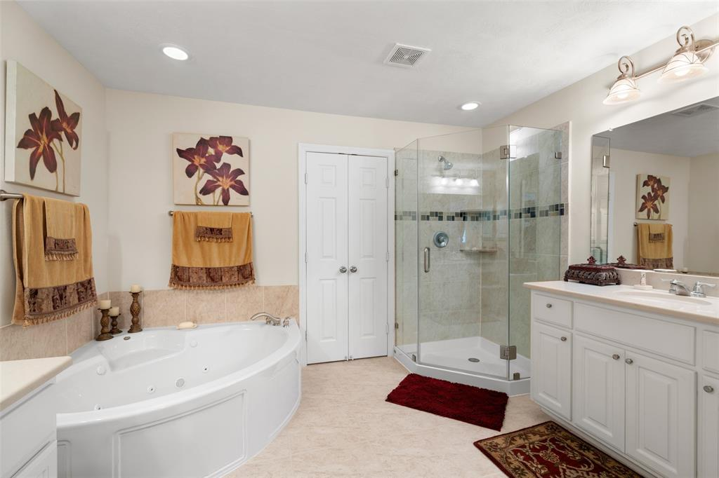 The master bath also has a beautiful shower with updated glass enclosure.