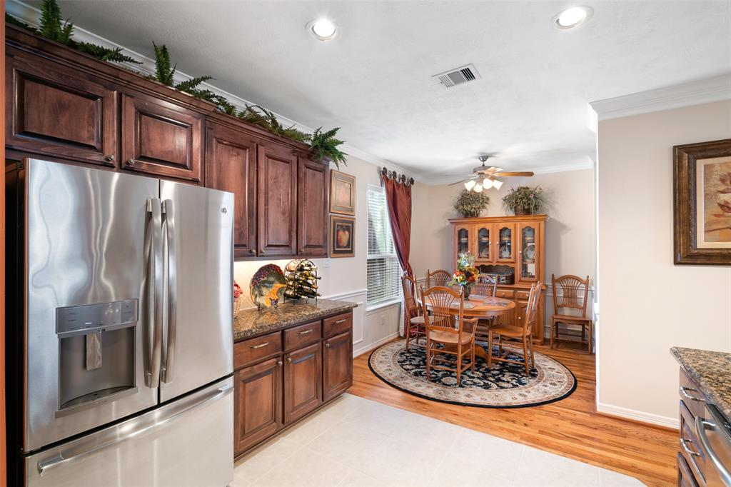 The kitchen also opens to a breakfast space.