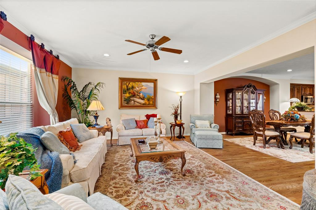 The living space and entire second floor features wood floors, crown molding and lots of natural light.