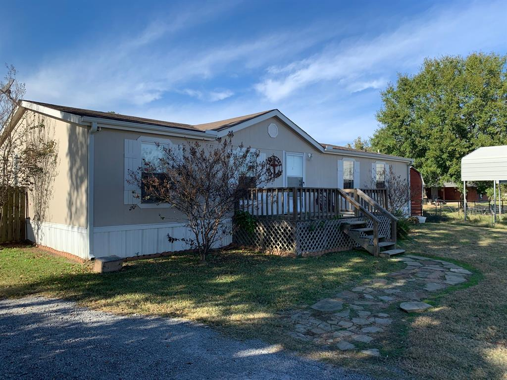This property is located right on the edge of town off of FM 1119 and affords country living with the convenience of being in town.  There is approximately 4.779 acres (per CAD) of land that is mostly open pasture, fenced, and has a nice pond.  The house is a 2014 model double wide that has 3 bedrooms and 2 baths and is in very good condition.  There is also a shed and carport.  Excellent location in a nice quiet area with some room to roam.