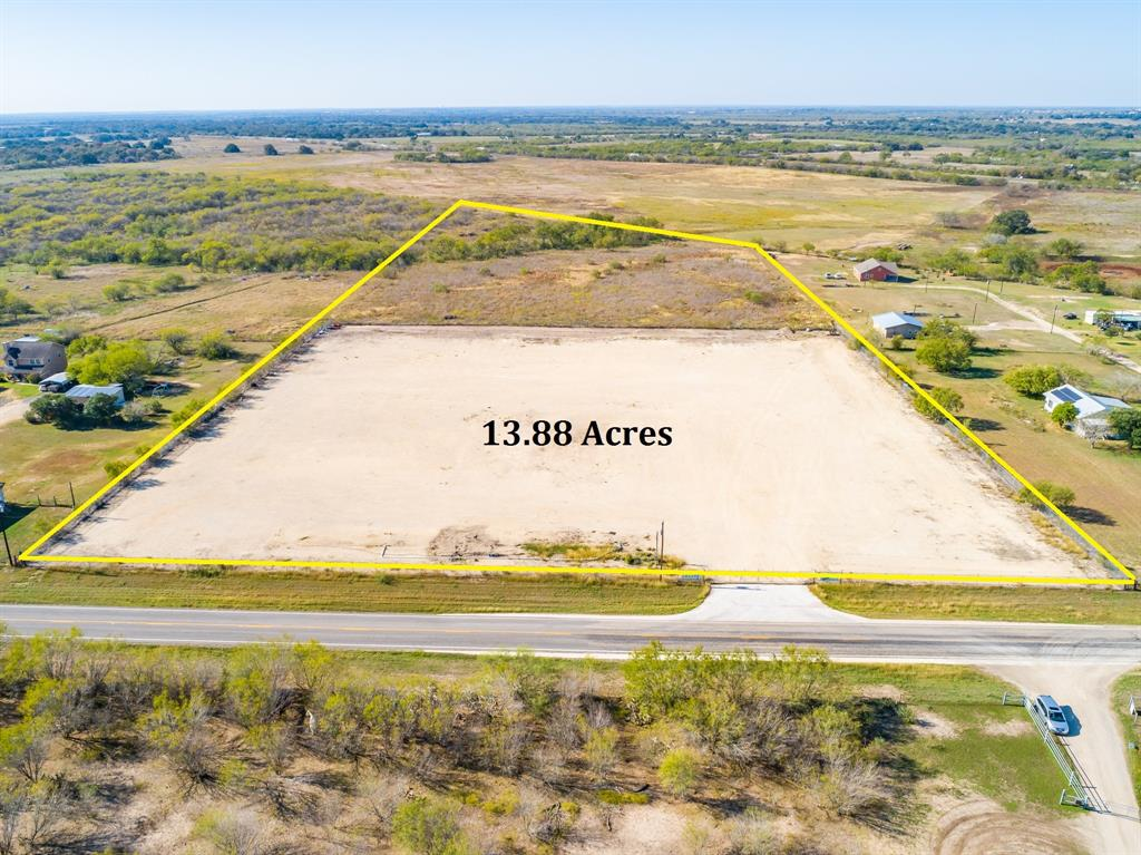This property was formally a truck yard. Of the 13.88 acres, 5.34 acres is fenced and stabilized. The additional 8.54 acres is native pastureland with a small pond, great for Dove hunting. Public water & aerobic septic system. The seller is not familiar with any aspects of the septic system, it was installed by the previous tenant. Recent survey available. Property was recently leased for 4,500 per month. Triple net.  Cash on cash return is 13%. Call listing agent for details.m