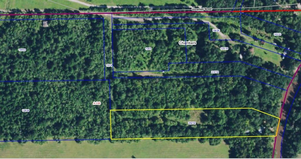 Build your dream home on this peaceful, wooded waterfront property. 5 Acres of unrestricted land with water and electric available. Take a short 4.5 mile boat ride down to the bay for amazing fishing!