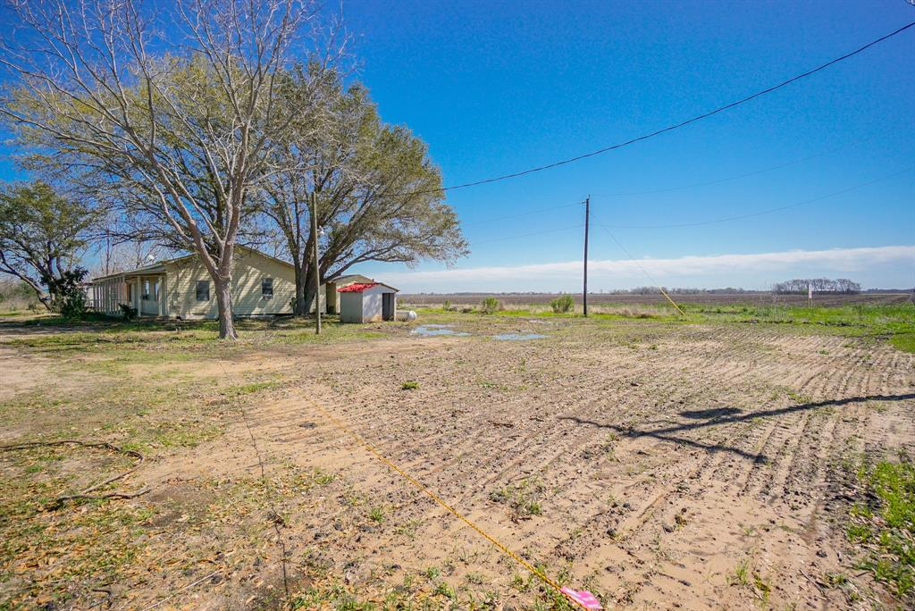 Enjoy country living in this renovated single story home on 0.5 acres of lot fronting FM 2919! Two master bedrooms, both with sitting area! Spacious living room!  New aerobic drip septic system with county permit installed on January of 2020!  Two brand new AC units with heat!  New floor in laminate, tile and carpet, new painting in and out,  large portion of siding replaced! Brand new stainless steel range, granite tile counter top and ceiling fans! New light fixtures, faucets, vanities and mirrors! Wheelchair accessible shower and bathroom,  large porch and covered patio! Only a few minutes of driving  to restaurants, clinic and shopping in city of East Bernard!  Only 19 minutes  of driving to Town Center in Rosenber! Low tax! No HOA restrictions or HOA fee!