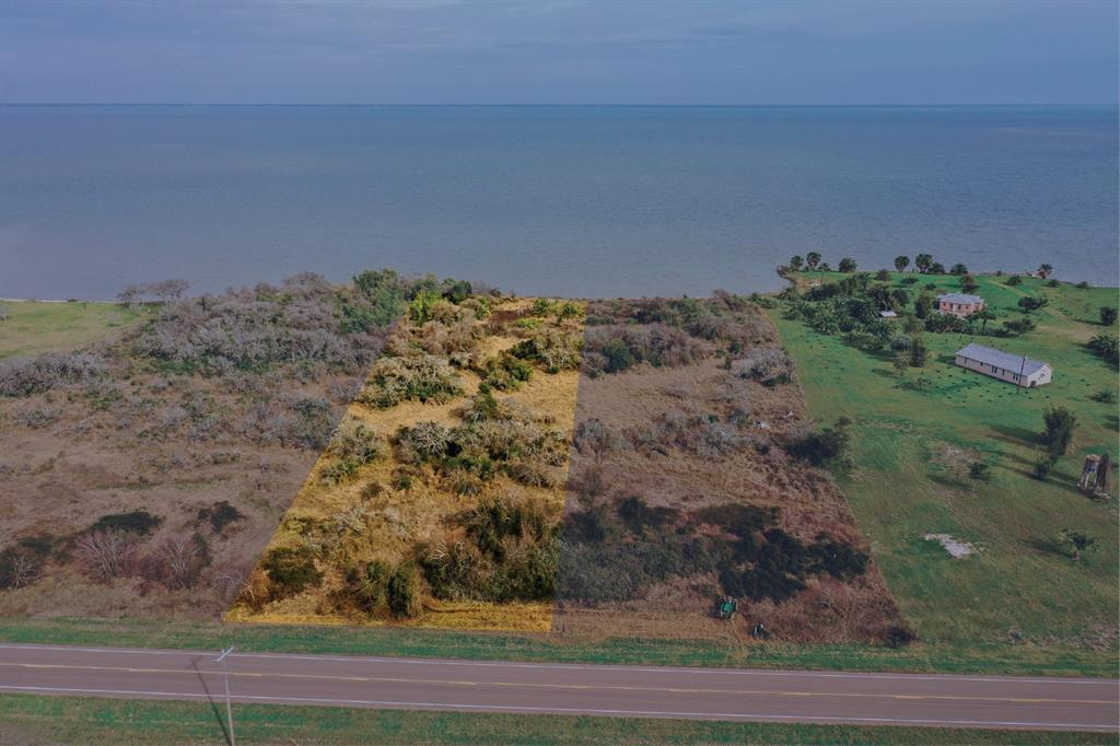 Tract D: ~2 AC home site with panoramic waterfront view of San Antonio Bay (a year-round trout and red fish mecca)! A public boat ramp/marina is accessible only 1/2 a mile from the property in one direction and Aransas Wildlife Refuge is just a few miles away in the other direction. The property boasts its own abundant wildlife, with whooping cranes and other birds, as well as visible game trails for deer. The property can be accessed with ease via a superhighway and is only 2.5 hours from Houston and San Antonio or 3 hours from Austin.