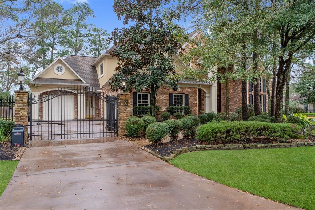This magnificent Bill Hughes custom home is located in Grogan's Mill in the front of The Woodlands and minutes from Town Center. Hardwood flooring throughout entire home with exception of wet areas, master suite, and study. High ceilings, crown molding, granite countertops, wine room, elegant formal dining and living rooms, study, game room, 3 attic spaces, oversized 2 car garage and separate single car garage with heating/cooling and home stereo system are just of few of the many features of this gorgeous home. The gourmet kitchen boasts an oversized island and large walk-in pantry that overlooks the family room with corner fireplace and custom built-ins. Escape to the private master suite featuring huge walk-in his and her closets, double vanity, jetted whirlpool tub, and walk in shower. This home won't last long. Schedule your showing today!