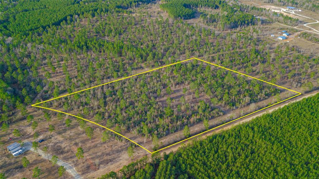 Beautiful tract of land totaling just under 11.5 acres, minutes from Lake Livingston and only an hour from The Woodlands. Property is level with hardwood trees, 2 acres have been cleared for a home site. Property features electricity and fiber optics along the 800' of road frontage. This tract is one of many, that have already sold, in a beautiful new restricted ranch community. Lots of wildlife, horses and livestock are welcome. No Floodplain! Call to schedule your showing today.