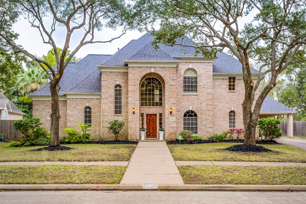 DID NOT FLOOD IN HARVEY - Stunning 5 large bed, 3.5 bath with 2 car detached garage & carport for 2 cars, lots of off street parking on cul de sac street. This custom home located in gated section of Cinco Ranch South Lake is right around the corner from Cinco Ranch Golf Club. This home has been lovingly updated & sure to please your buyers. No detail has been overlooked in this home. Large kitchen on open plan to breakfast room & den, large formal living room,dining room, huge game room with huge balcony overlooking the golf course, large sparking heated pool & hot tub, grass area for pets or soccer! Master suite has door out to the hot tub & pool, new tile floor that looks like wood. Master bathroom has been fully updated with spa like feel with beautiful bath, seamless glass shower, his & her closet. Lots of space & tons of storage throughout. Roof 2018. Walk to YMCA, Life Time Fitness, Sprouts, fishing lakes, walking trails and Beach Club! Come see this wonderful home today!