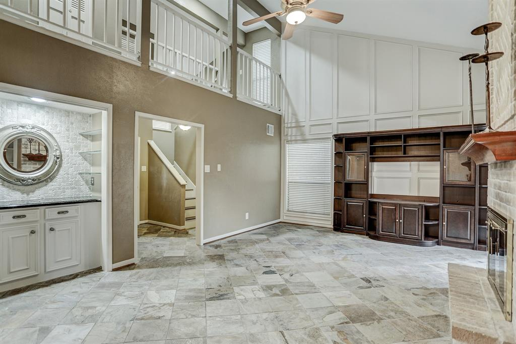 Fabulous open living room! Drybar and built-in entertainment center...amazing!