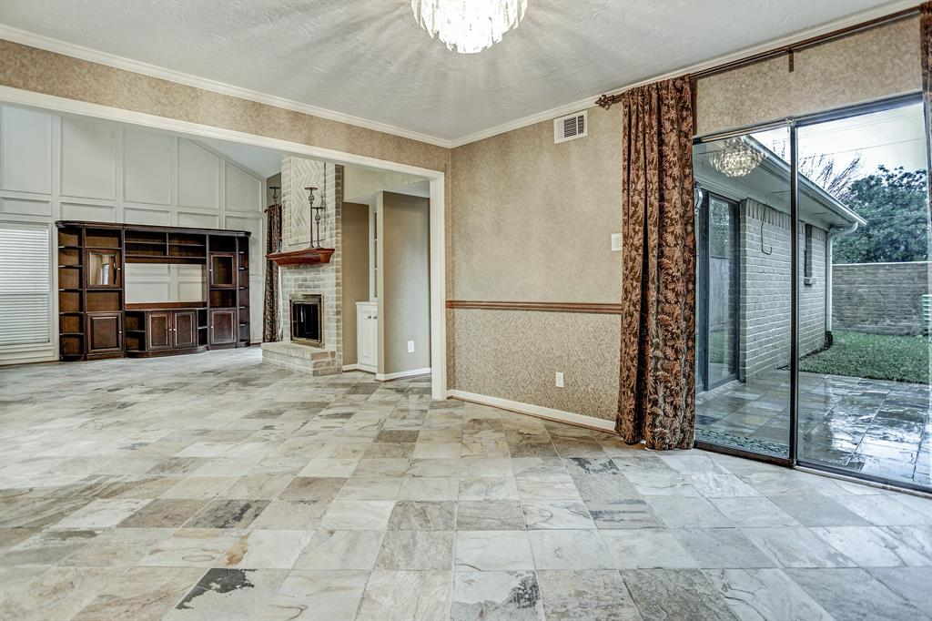 Dining room with access to patio and backyard.