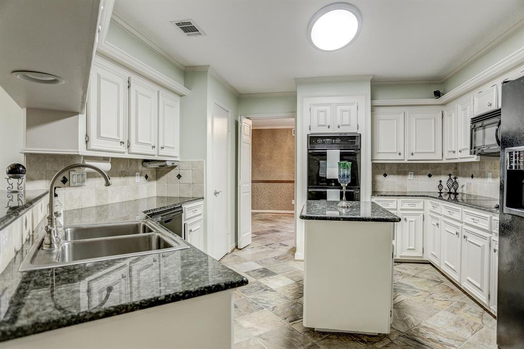 Granite counter-tops, tons of cabinets, all appliances included and island for prepping.