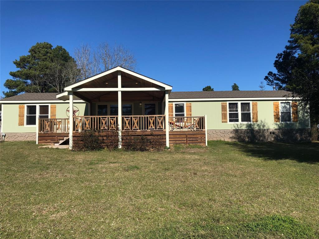 Wonderful property located in the Lovelady School District.  This 2008  5 Bedroom 2 bath manufactured home offers over 2300 square feet  of heating and cooling . This Double wide home has a huge living and dining room with Double Glass doors that step out to a huge covered back porch. This will  lead  you to the beautiful pond at the back of the property  The kitchen boasts tons of cabinets and pantry with Island bar and a Gas Stove. The Master bedroom has double sinks,glamour tub, separate shower and walk in closet.  The other 4 bedrooms are a nice size  with plenty of closet space!  Plus large utility room.  The outside has a front porch with ceiling fan and recessed lights to enjoy the peaceful outdoors.  The property has its own water well and comes with a fully fenced 8.33 acres. This is a must see property!!