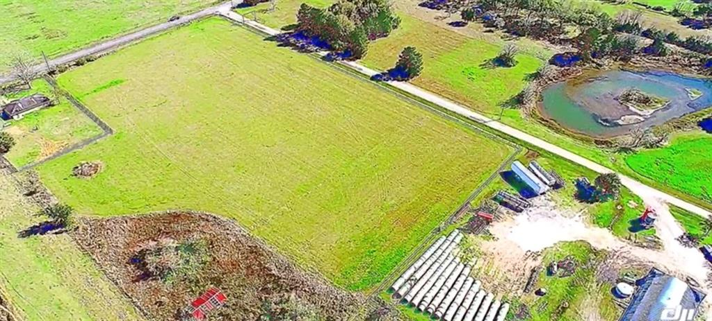 Just under 5 unrestricted acres - cleared and ready to build your dream home.  Quiet neighbors and less than 10 minutes from Houston Premium Outlet mall.  Country charm with city convenience!