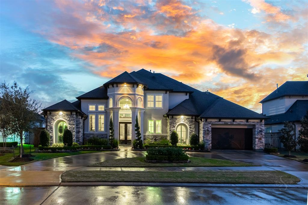 LUXURY living at it's finest here at this elegant 4,954 sf estate home in Legacy at CCR providing high-end living inside & out. This 5 bedroom (2 DOWN), 5.5 bath showplace backs to a green belt & sits on a large cul-de-sac lot where guests arrive at the circular driveway & magnificent front elevation. Rich hardwood flooring in grand entry & study w/incredible built-ins. Breathtaking sunlit 2 story family room w/impressive details incl wood ceiling beams, ceiling high stone fireplace & stacked windows overlooking back yard PARADISE w/ incredible custom POOL & SPA w/ slide & tanning ledge & next to amazing extended covered patio w/OUTDOOR KITCHEN & FIREPLACE. Gourmet kitchen w/double ovens, built-ins off kitchen, game & media rooms, huge utility room, flex room, mud room & 3 car tandem garage. Master bdrm & bath w/enormous custom shower & whirlpool tub. Zoned to KatyISD & the new Adams Jr High & Jordan High (in 2020), both in CCR! This extraordinary home offers the luxury you deserve!
