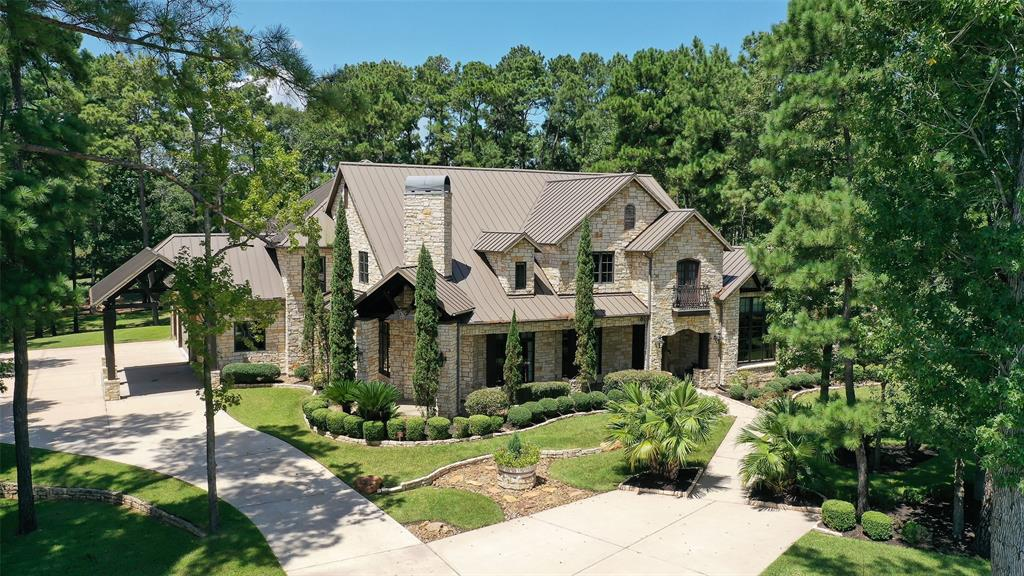 """Stunning Custom home on approx 1.3 wooded acres on the 18th hole of High Meadow Golf Course! Located in the prestigious gated section """"The Falls"""". This home won the GHBA Prism award in 2007 - Custom home of the Year!This home has it all! Gourmet kitchen w/ built in refrigerator, 6 burner commercial grade stove w/ double ovens plus full working pantry! Wet bar up & down plus wine room!Both Formals which have a fireplace in dining room, Family room w/ Vaulted beam ceilings & French door opening to the huge covered patio w/ fireplace that overlooks the Golf Course! Formal study & kids study up, Exercise room off master closet, Upstairs is Game room/Media room combo w/ 2nd wet bar + 1/2 bath, All bedrooms en suite +private play room between 2 of the bedrooms! Great for kids or Grands! Attic was converted to a full size room over garage that is accessible from upstairs by desk area! Separate Guest Quarters! Additional Falls amenities include putting green, jogging trails & fitness area!WOW!"""