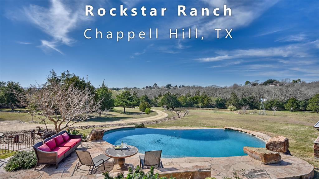ROCKSTAR RANCH will delight every member of the family!  TURN KEY OFFERING includes furnishings, household items, equipment and toys!   Drive down the tree lined driveway to this tucked away retreat near the historic town of Chappell Hill, less than one hour from Houston. 8.4 secluded acres of rolling landscape bordered by woods with mature trees and a pond stocked with bass & catfish.  Spacious one-story Austin Stone home (2849 SFLA) with wrap around covered porches, irrigated landscaping, infinity pool, Guest House (980 SFLA), Party Barn and minutes from Hwy 290 between Houston and Brenham. MAIN HOUSE is set on a hill, beautiful wood floors, high ceilings, 3 bedrooms, office, 2 full baths, 1 half bath, laundry room, living area with fireplace open to island kitchen. GUEST HOUSE  2 bedrooms, 1 full bath, laundry room. PARTY BARN with 2 large roll up doors and covered extension. WORK SHOP  WELL HOUSE  FISHING POND, walking trails and deer feeder
