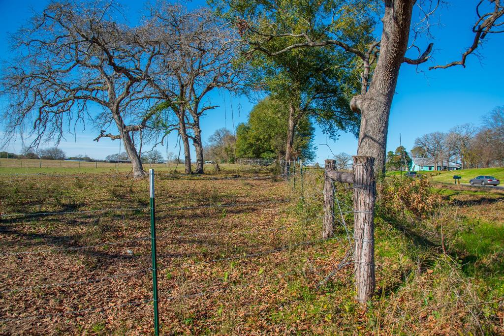 Gorgeous 60 acres with over 1000 feet of highway 36 frontage just 7 miles south of highway 21 and in Caldwell ISD. Property has been cleared out like a park with scattered trees and a creek. Perimeter fencing and cross fencing. Two driveways and a nice cleared spot to build your home.