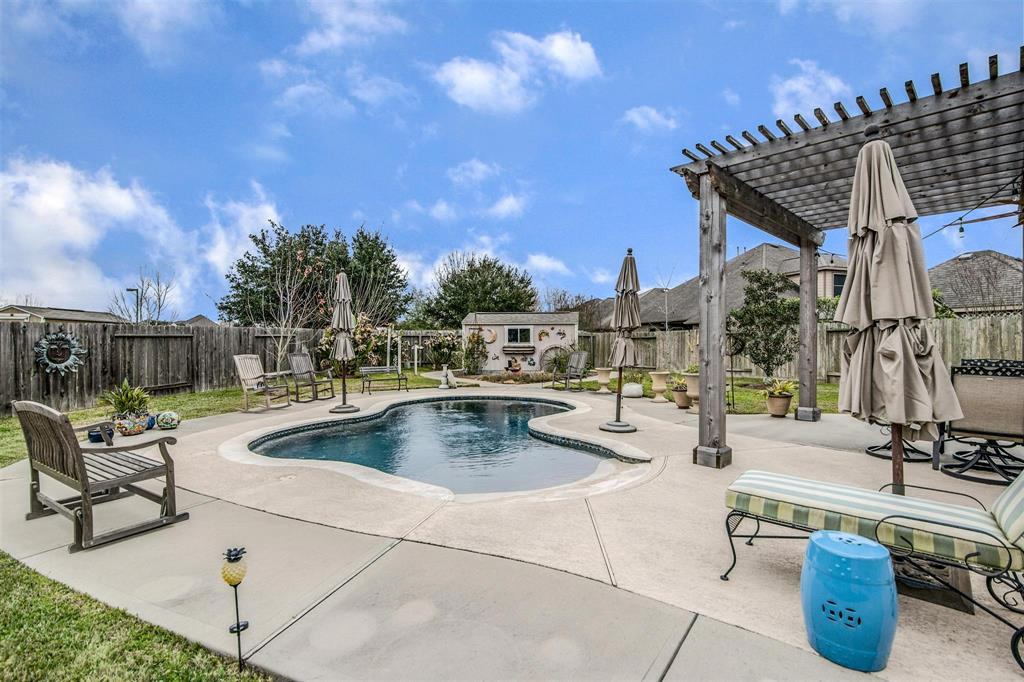 Picturesque Perry home located in the prestigious Reserve at the Brazos Town Center!  This stunning home offers many upgrades from the sparking pool, crown molding throughout most of the house, engineered hardwood floors and stylish light fixtures, to name a few.  Back yard is a relaxing oasis with two pergolas and a covered patio where you can relax with a glass of wine after a long day.  This home is great for entertaining from the spacious back yard to open kitchen/living concept. Kitchen offers stainless steel appliances with gas cooktop and double oven, also included is a pot filler facuet. 3 car garage with epoxy flooring, large storage room with built in closet, utility sink and lots of extra cabinets.  Home is located on a cul-de-sac court. Generac whole-house generator to stay with the home. Walking distance to amenities , dog park, walking trails, shopping and restaurants. This home is a must see! Home has did not flood during Harvey.