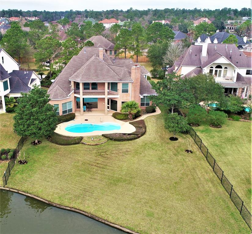 Very rare chance to acquire a waterfront property on Lake Woodlands. Lovingly maintained and updated on a regular basis. Great floor plan with a large study with built-ins, living and family rooms flow into the kitchen, also has thee full baths and 2 1/2 baths which is great when entertaining. Enjoy waking up and looking out to the pool and lake right behind your home. Take coffee on the patio or balcony with the wonderful view. This property will not last. Come and check out this spacious, well maintained home with beautiful views. Room dimensions are estimates only, buyer should verify all data including schools. Click on the small film reel icon at the top of this page to take a virtual tour of the home. New carpeting, so please use the available shoe covers at the front door or remove your shoes, Thanks!