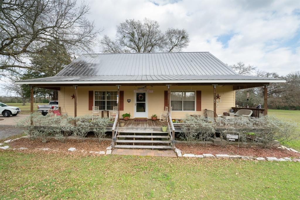 If you are ready to move to the country, this Picturesque Ranchette in Normangee, Madison County on 10.5 acres may be it.  This custom Hardi Plank home features 2 bedrooms, spacious loft, 2 full baths and 2 car detached carport.  The kitchen has custom cabinets with antique old world glass facing, island and walk in pantry, the first floor has high custom ceilings, a spacious loft and there are beautiful front and back porches for drinking coffee and viewing wildlife.  Other features include an adorable 624 SF Cabin that functions as a guest house, a 30x30 workshop, catfish and blue gill stocked pond with pier, automatic driveway gate, and paved road frontage.  The acreage is approximately 40% open and 60% wooded presenting with a regular shape and a mixture of hard and soft woods.  Make this your full time residence or a weekend retreat.