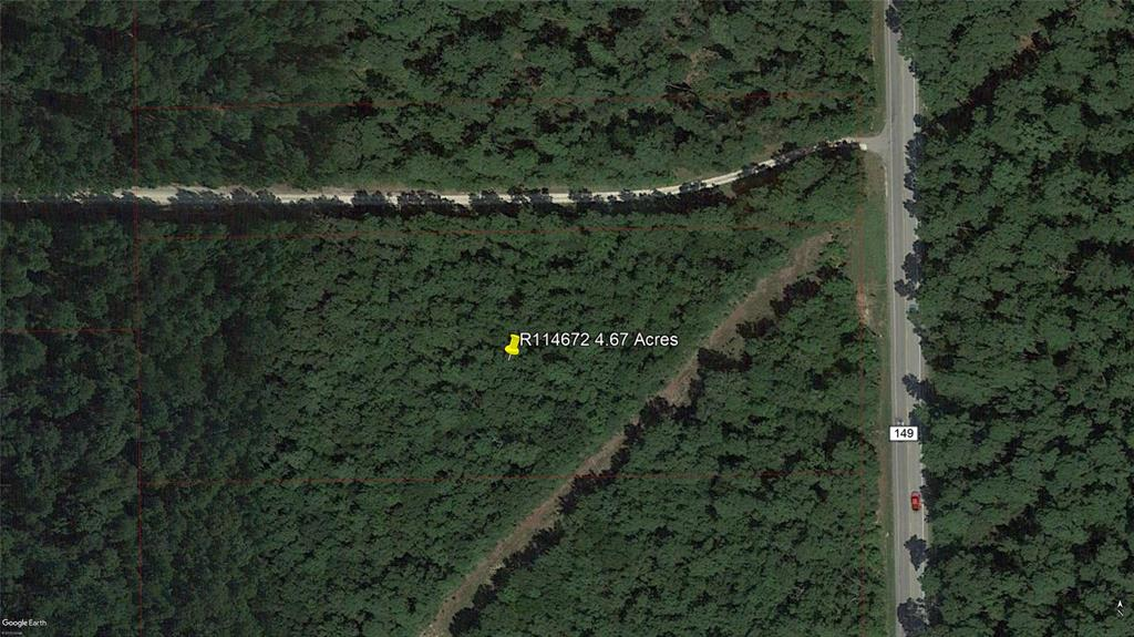 4.67 acres of rolling, wooded unrestricted acreage within minutes of Oak Hills Junior High and Lake Creek High Schools.  260 feet of frontage on FM 149.
