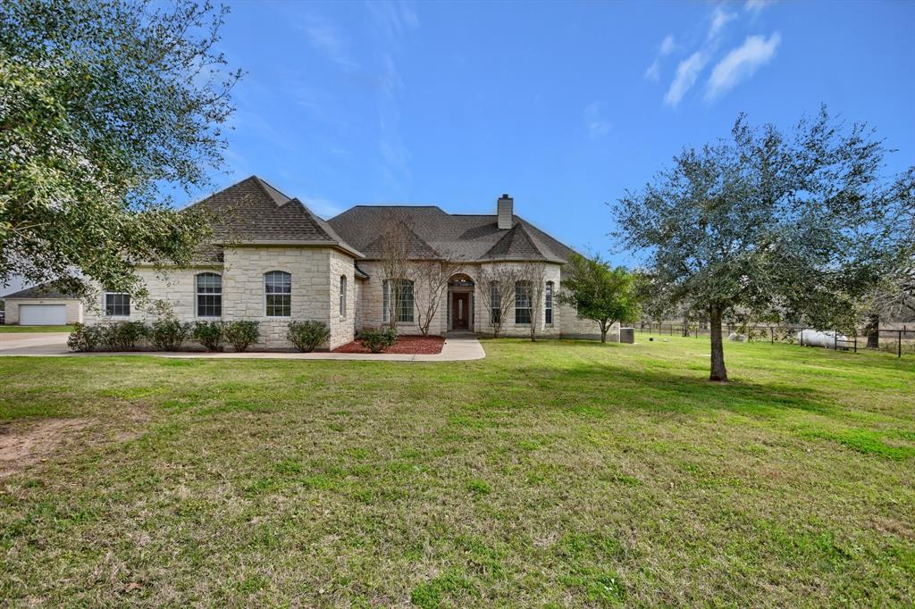 This beautriful 4B/3BA +½ BA home is located just a few miles from the charming town of Smithville between Austin, Houston, San Antonio and Bryan-College Station. Features include kitchen/breakfast area with an open concept, spacious living areas with vaulted ceilings, fireplace and a covered back porch for simple lounging while enjoying the pool and outdoor living. This 11 acre ranchette includes a 40x40 barn/tack room, horse barn with livestock pens and pond. A MUST SEE!