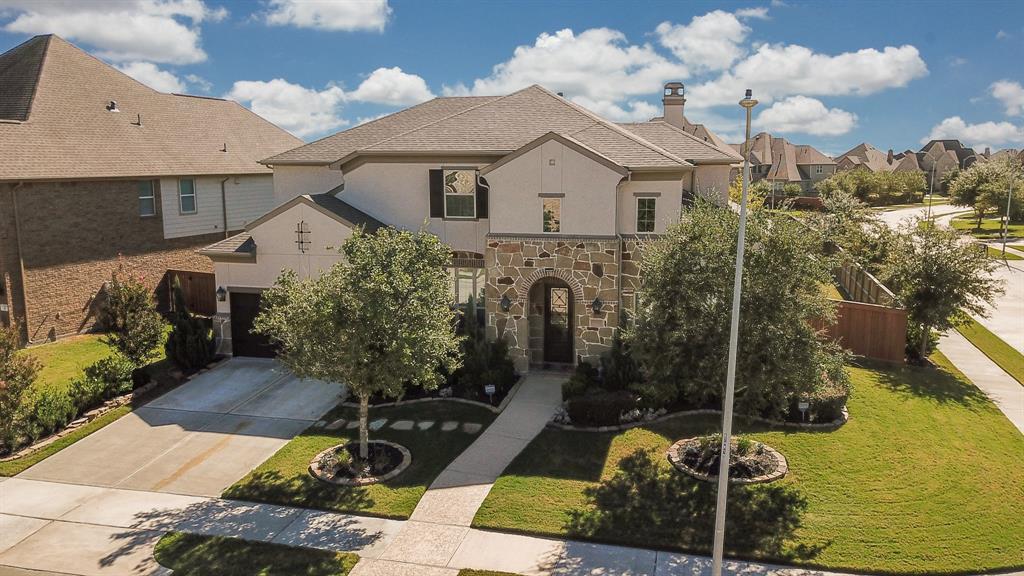 Gorgeous Mediterranean Style Stucco-Stone Highland Home in the Master Planned Community of Aliana. Built on an Over-sized CORNER LOT w/ Upgrades Galore, this home has it ALL! Welcome Home through an Arched-Stone Front Elevation followed by a Beautiful 8 ft Glass Leaded Front Door. After stepping inside, you will be wowed by a HIGH Ceiling Foyer, Stunning Curved Staircase & Wood-like Tile flooring! To the right you will find the Study w/French Doors. On the left is the Elegant Formal Dining w/Custom Chandeliers. Kitchen featuring Exotic Granite Counters w/ Oversize Island, GE CAFE Series SS Appliances, Benedettini SELF-CLOSING Cabinets, Mosaic Back splash & Butlers Pantry. Family Room w/Soaring High Cathedral Ceilings & Stunning Stone Fireplace! Master Suite + Additional Bedroom down! MasterBath w/Walk-in Shower & Garden Tub. Other Features incl. Game/Media Room, Covered Patio, Outdoor Kitchen, Water Softener & Sprinklr System,Garage w/Epoxy flooring  & Enjoy LOWER PROPERTY TAX SECTION!