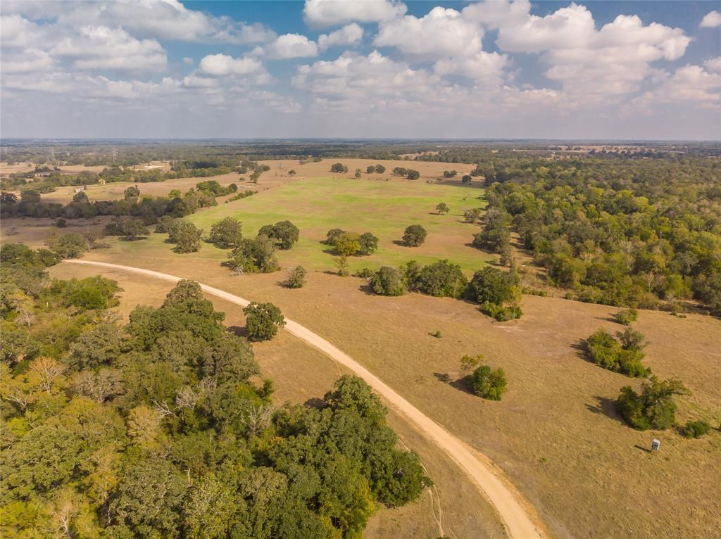 Aprx 1517 acres, working ranch has been in the family since 1933. Just 45 minutes from College Station and well under two hours from downtown Houston. Gently rolling topography from the front entrance to the Navasota River bottom, 1.5 miles of river frontage. The property is to be sold in its entirety to one buyer. It is rare that a tract of this size comes available inside the Texas Triangle. Property includes a 4 bedroom, 2 bath ranch home as well as a quality manufactured home with 3 bedrooms and 2 baths.