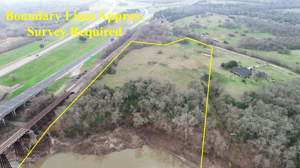 6+/- acres of ag exempt land located on the Navasota River! This tract offers a unique opportunity, it would make a beautiful home site or just a nice hold for private river access anytime you wanted! The property has power running across the front corner but does not have public water or sewer. There will be some minor restrictions put in place. This is a partial sale down a private road so County approval is required. Survey will also be required. Please see the Aerial for approximate boundaries. Call today with any questions!