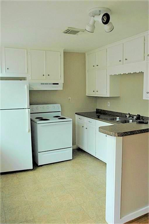 The kitchen is bright and roomy with a breakfast bar.