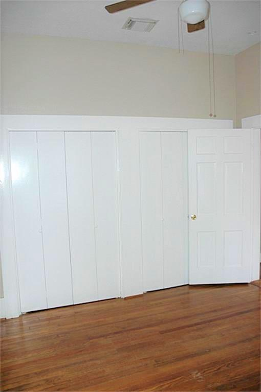 The bedroom includes a full wall of closet space.