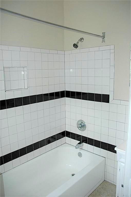 The bath with a full size shower stall/tub combo.