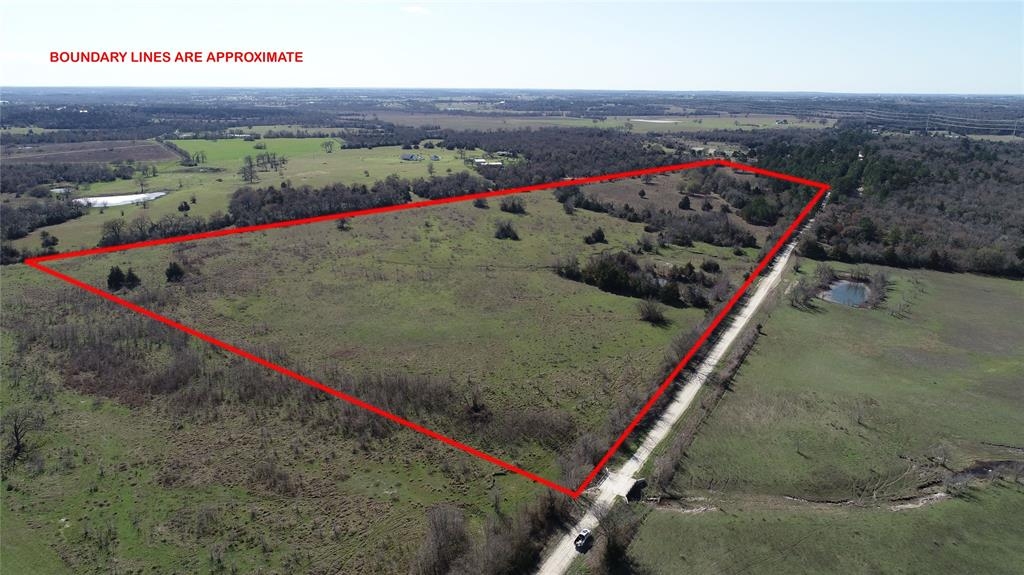 40 spectacular acres on CR 219 being split off from a a larger parcel. With approximately 1960 ft of county road frontage, this property leaves allot of opportunity on the table. Electricity is about 1450 ft away from this parcel on the adjoining tract and the seller will grant a 20' wide electrical easement along CR 219 to the buyer.  This property has a 1 pond and two small watering holes for the cattle. Fenced on three sides, Beautiful views and very nice trees on the southern end. Lots of potential build sites. This will be great opportunity for someone looking to build their dream home in the Anderson-Shiro School district. Must see!! Properties like this are hard to find!