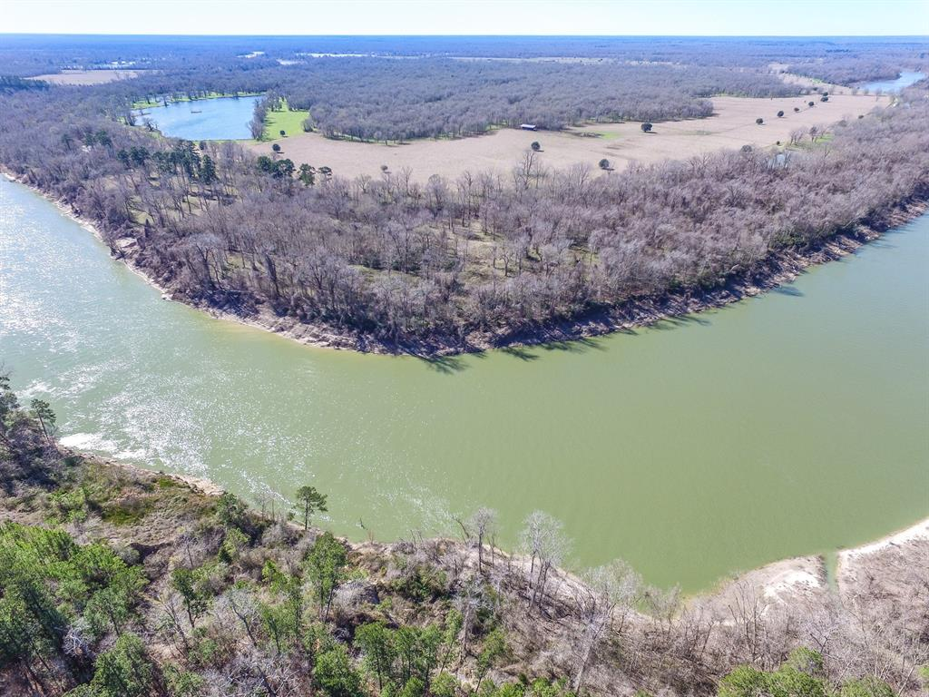 20 Acres of RIVERFRONT. This property front FM 2610 and runs to the Trinity River. There is approx. 800' of river frontage, with approx 650' along  FM 2610. Wooded with a mixture of pine and hardwood. Fenced along the FM road. This property would make a great place to build or hunt/fish.