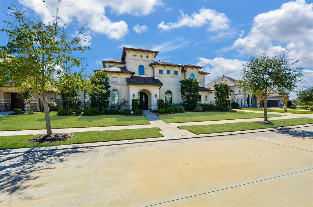 One of Toll Brothers most popular designs, this gorgeous home is everything you'd expect from high end luxury in the sought after community of Riverstone in Sugar Land. There are  2 bedrooms down, the master & one which could serve as nursery,guest room, workout rm w/its own  private bath. From the magnificent entry with elegant chandeliers and double staircase to the upstairs gameroom & media room this home will give you the comfort and space you desire. All bedrooms are spacious with wonderful closet space. You will love the 3 car  garage and covered patio with oversized backyard, ready for your personal touch or a swimming pool. 